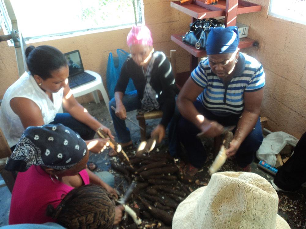 Women peeling yucca to make cassava