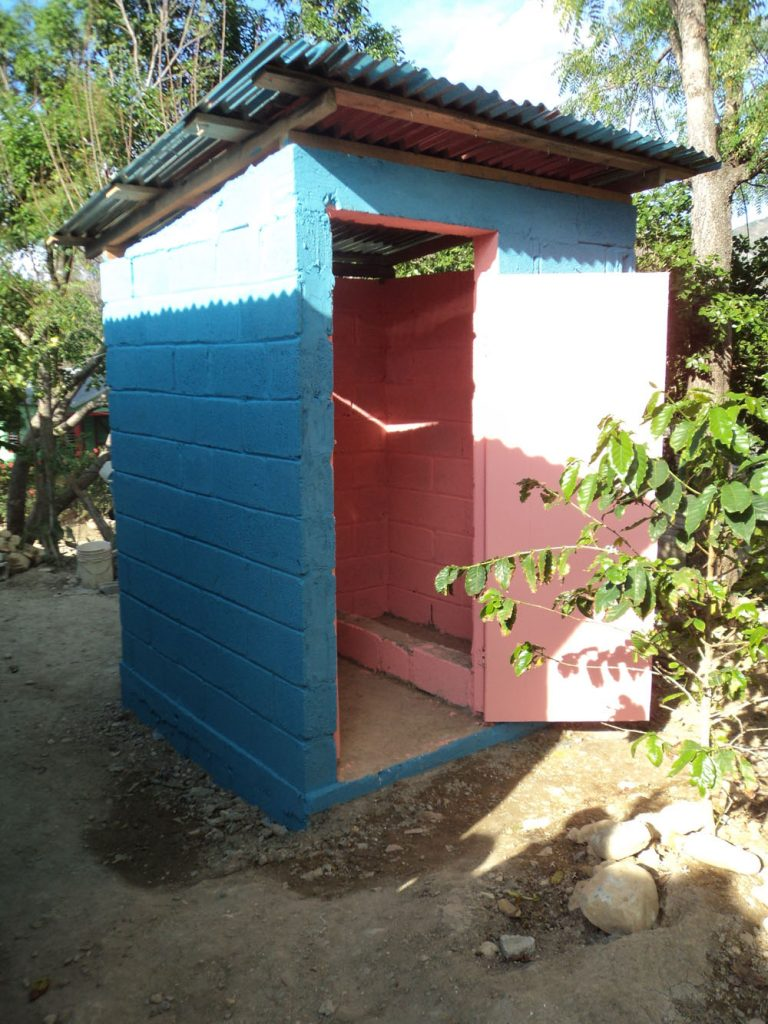 Outdoor latrine to improve sanitation.